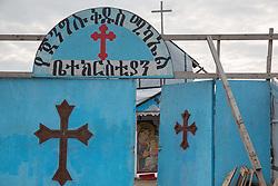 """Calais, Pas-de-Calais, France - 16.10.2016    <br />     <br />  Christian church of Eritrean refugees in the """"Jungle"""" refugee camp on the outskirts of the French city of Calais. Many thousands of migrants and refugees are waiting in some cases for years in the port city in the hope of being able to cross the English Channel to Britain. French authorities announced that they will shortly evict the camp where currently up to up to 10,000 people live.<br /> <br /> Christliche Kirche von Fluechtlingen aus Eritrea im """"Jungle"""" Fluechtlingscamp am Rande der franzoesischen Stadt Calais. Viele tausend Migranten und Fluechtlinge harren teilweise seit Jahren in der Hafenstadt aus in der Hoffnung den Aermelkanal nach Großbritannien ueberqueren zu koennen. Die franzoesischen Behoerden kuendigten an, dass sie das Camp, indem derzeit bis zu bis zu 10.000 Menschen leben Kürze raeumen werden. <br /> <br /> Photo: Bjoern Kietzmann"""
