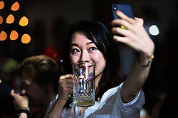 August 1, 2018 - Qingdao, China - Selfie time as people enjoy beer during the Qingdao International Beer Festival in Qingdao, east China's Shandong Province. (Credit Image: © SIPA Asia via ZUMA Wire)