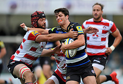 Adam Hastings of Bath Rugby fends Gareth Evans of Gloucester Rugby - Mandatory byline: Patrick Khachfe/JMP - 07966 386802 - 13/09/2015 - RUGBY UNION - Memorial Stadium - Bristol, England - Gloucester Rugby v Bath Rugby - West Country Challenge Cup.