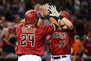 PHOENIX, AZ - JULY 06:  Brandon Drury #27 of the Arizona Diamondbacks is greeted at home by Yasmany Tomas #24 after hitting a two run home run during the third inning against the San Diego Padres at Chase Field on July 6, 2016 in Phoenix, Arizona.  (Photo by Jennifer Stewart/Getty Images)