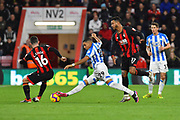 Abdelhamid Sabiri (29) of Huddersfield Town is challenged by Lewis Cook (16) of AFC Bournemouth during the Premier League match between Bournemouth and Huddersfield Town at the Vitality Stadium, Bournemouth, England on 4 December 2018.
