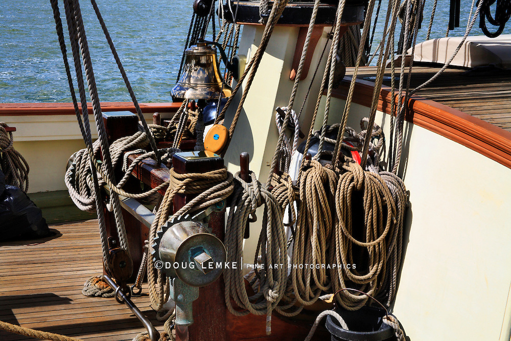 The Ropes, Rigging Pulleys And Bell At The Foot Of The Mainmast On An Antique Replica Sailing Vessel