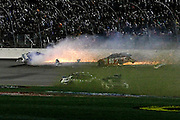 Drivers spin into the infield as David Gilliland, top left, and Justin Allgaier (51) hit the wall during a NASCAR Sprint Cup Series auto race at Kansas Speedway in Kansas City, Kan., Saturday, May 10, 2014. (AP Photo/Colin E. Braley)