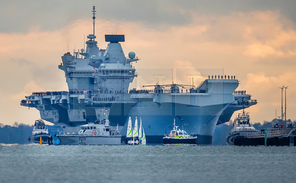 © Licensed to London News Pictures. 16/11/2019. Portsmouth, UK. HMS Prince of Wales, sister aircraft carrier of HMS Queen Elizabeth, sails into it's home port of Portsmouth for the first time. The Royal Navy's  latest aircraft carrier sailed from Rosyth dockyard to begin sea trials in September. The ship, which is 280 metres long and weighs 65,000 tonnes, is expected to commission into the Royal Navy in 2020. Photo credit: Peter Macdiarmid/LNP