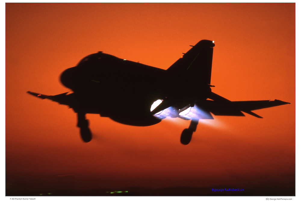 F-4, USMC, in full afterburner against sunset.