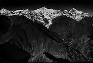 The massive climatic and ecosystem diversity below the 6,740 m (22112 ft.) high massif of Kawagarbo (Meilixueshan in Mandarin). Kham, Tibet (Yunnan, China)<br /> <br /> In 1997, Kawagarbo was not yet open to foreigners.  Travel beyond Zhongdian, not yet renamed Shangri La, was forbidden.  Independent travel beyond Kawagarbo into Tibet Proper (Tibet Autonomous Region) is still forbidden to foreigners.<br /> <br /> Mingyong Glacier which can be seen trumbling down from the face of the 6,740 m (22112 ft.) Kawagarbo (Meilixueshan in Chinese), the highest peak in Shangri-La and Yunnan.  The glacier has receded 200 m (656 ft.) in four years, and 522m (1,713 ft) since 1983.  <br /> <br /> It is sacred to local Tibetans.  Deqin, Kham, Tibet (Deqin, Shangri-La, Yunnan, China)  At 28.5 degrees north and an elevation of 2700 m (8858 ft), it is the lowest and southernmost glacier in Tibet/Peoples Republic of China.<br /> <br /> About 1.3 billion people depend on the rivers that flow from the Tibetan Plateau.  The glaciers are shrinking, the permafrost is melting and releasing methane, a greenhouse gas, and wetlands are drying out, all due to climate change.  <br /> <br /> In fact, the glaciers of Tibet, according to the Institute of Tibetan Plateau Research of the Chinese Academy of Sciences (CAS), have melted faster than anywhere else on the planet.  Tibetan glaciers have lost 15% percent of their mass in the past three decades and global warming could further intensify the melt.Glaciers are shrinking, the permafrost is melting and releasing methane, a greenhouse gas, and wetlands are drying out, all due to climate change.