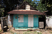 Traditional ramshackle Creole house in the town of Sinnamary, French Guiana.