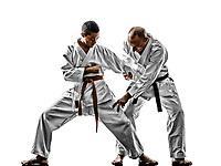 two karate men sensei and teenager student teacher teaching isolated on white background