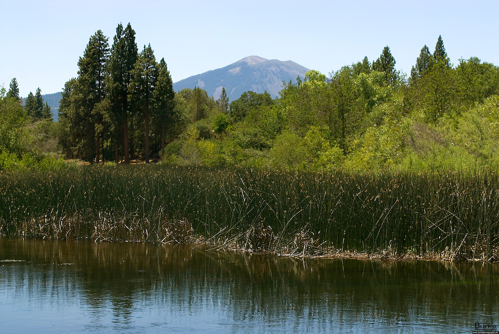 With Hat Creek in the foreground and Lassen Volcanic National Park in the background, this fishing hole is one of the best in the North State.  Lassen Park in California provides a wealth of fun activities that are as varied as the seasons of the park. Due to the high elevation and influence of the Pacific Ocean, the park receives upwards of 40 feet of snow per year.  The dominant feature of the park is Lassen Peak; the largest plug dome volcano in the world and the southern-most volcano in the Cascade Range.  The park is located about 45 miles east of Redding.