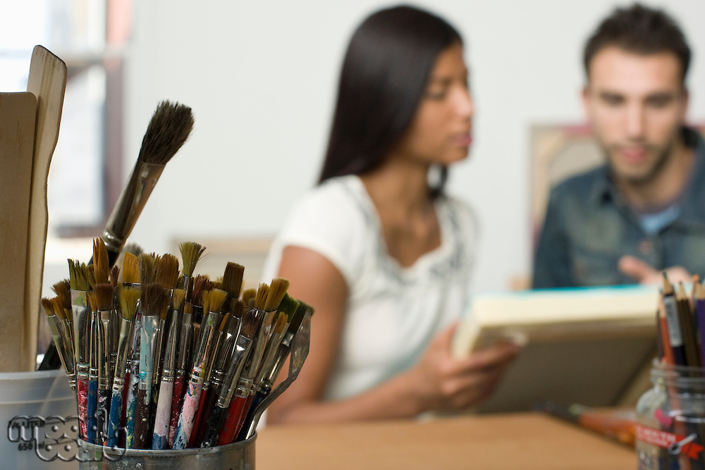 Paint Brushes on Artist's Work Table