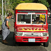 Colorful little buses shuttle people around the island, Pago Pago, Tutuila Island, American Samoa.