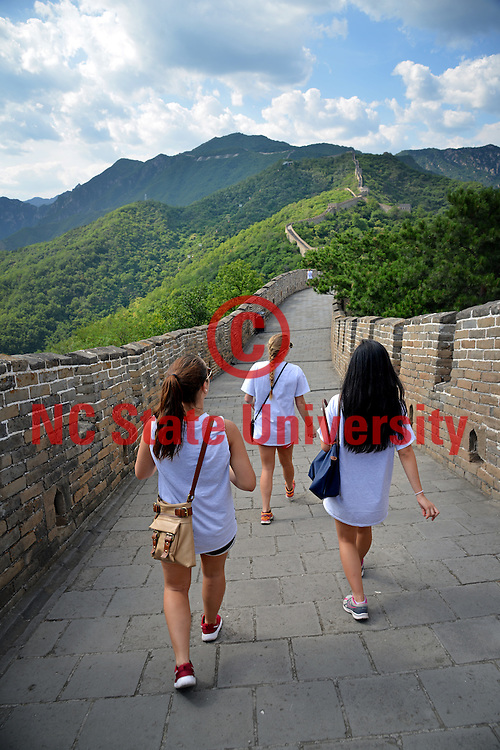 Poole College of Management Study Abroad students hike the Great Wall.