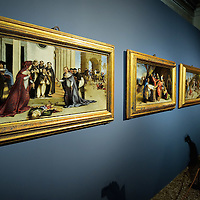 VENICE, ITALY - NOVEMBER 23:  A woman admires paintings by Lotto at the press preview of Tribute to Lorenzo Lotto - The Hermitage Paintings at Accademia Gallery on November 23, 2011 in Venice, Italy. The exhibition which includes two very rare & never seen before paintings opens from the 24th November 2011 to 26th February 2012 in Italy.