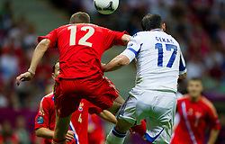 Aleksei Berezutski of Russia vs Fanis Gekas  of Greece during the UEFA EURO 2012 group A match between  Greece and Russia at The National Stadium on June 16, 2012 in Warsaw, Poland.  (Photo by Vid Ponikvar / Sportida.com)