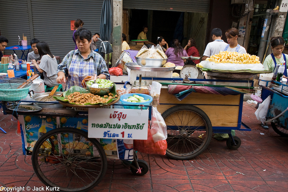 02 MARCH 2008 -- BANGKOK, THAILAND:  Push cart food vendors in the Chinatown section of Bangkok, Thailand.    Photo by Jack Kurtz