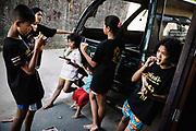 Bangkok, November 2 - 2013 Blood, sweat and tears: Muay Thai child fighters<br /> Many children are sent by parents from the rural regions in northeastern Thailand to Bangkok and other major cities to training camps in the hopes that their sons will become good fighters and be able to help the family financially.<br /> In Thai culture Muay Thai is a part of life and boys and girls train from an early age and it is not uncommon that children as young as these take part in tournaments in front of hundreds of spectators. Lumpinee Boxing Stadium / Petchsiam S.Thaweekan 13 Years OldBangkok, 2 novembre - 2013 Sang, sueur et larmes : Muay Thai enfants combattants<br /> De nombreux enfants sont envoyés par des parents des régions rurales du nord-est de la Thaïlande à Bangkok et dans d'autres grandes villes dans des camps d'entraînement dans l'espoir que leurs fils deviennent de bons combattants et puissent aider financièrement la famille.<br /> Dans la culture thaïlandaise, le Muay Thai fait partie de la vie et les garçons et les filles s'entraînent dès leur plus jeune âge et il n'est pas rare que des enfants aussi jeunes que ceux-ci participent à des tournois devant des centaines de spectateurs. Lumpinee Boxing Stadium / Petchsiam S.Thaweekan 13 ans