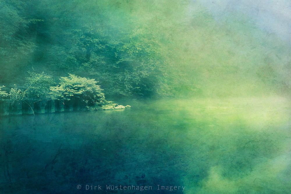 Rising morning fog over river Wupper in Germany<br />