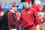 LITTLE ROCK, ARKANSAS - NOVEMBER 23:  Head Coach Dan Mullen of the Mississippi State Bulldogs and Head Coach Bret Bielema of the Arkansas Razorbacks talk at midfield before the game at War Memorial Stadium on November 23, 2013 in Little Rock, Arkansas.  The Bulldogs defeated the Razorbacks 24-17.  (Photo by Wesley Hitt/Getty Images) *** Local Caption *** Dan Mullen; Bret Bielema