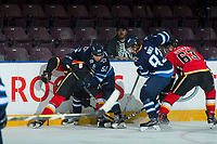 PENTICTON, CANADA - SEPTEMBER 11: Jansen Harkins #58 and Sami Niku #83 of Winnipeg Jets dig for the puck at the boards with Adam Ruzicka, #63 of Calgary Flames on September 11, 2017 at the South Okanagan Event Centre in Penticton, British Columbia, Canada.  (Photo by Marissa Baecker/Shoot the Breeze)  *** Local Caption ***