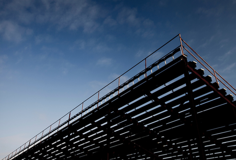 low angle view of stadium bleachers against a blue sky