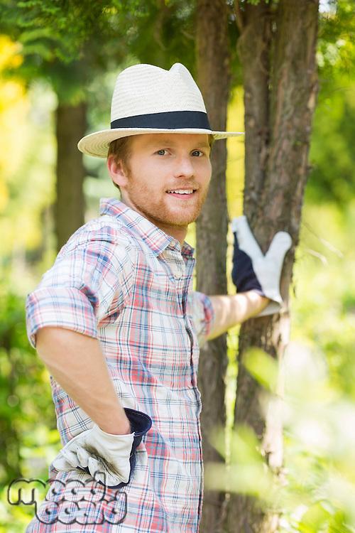 Portrait of confident gardener standing at plant nursery