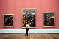 Woman looking at paintings at  Gemaldegalerie art museum at the Kulturform complex in Berlin Germany