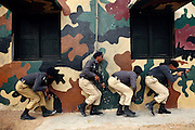 Recruits are taking part in a raid simulation exercise at the Shaheed Benazir Bhutto Elite Police Training Center, a commando and anti-terrorism academy on the outskirts of Karachi. The training center was founded by retired colonel Abdul Wahid Khan, a brave officer who served as a gunship helicopter pilot in the Pakistani Air Force and around the globe with the United Nations, but who's first task as a young army officer in 1979 was to train Afghan Mujahedeen to fight the Soviet Army, the very Mujahedeen that are today's Taleban.