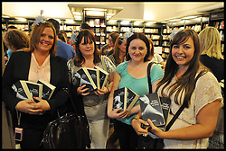 Fans wait to have their book signed by the  Author E L James attends her book signing at Waterstones, Piccadilly, London, author of Fifty Shades Of Grey author meets her fans as she signs copies of her bestselling novel, Thursday September 6, 2012 Photo Andrew Parsons/i-Images..All Rights Reserved ©Andrew Parsons/i-Images
