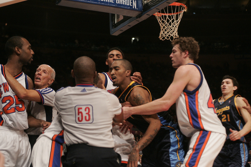 Members of the New York Knicks and the Denver Nuggets are pulled apart durring an oncourt fight at Madison Square Garden, New York City, on Saturday 16 December 2006 (Andrew Gombert for The New York Times)