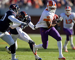 Clemson wide receiver Jacoby Ford (6) evades a tackle from Virginia cornerback Ras-I Dowling (19) and safety Corey Mosley (40).The Clemson Tigers defeated Virginia Cavaliers 13-3 in NCAA Division 1 football at Scott Stadium on the Grounds of the University of Virginia in Charlottesville, VA on November 22, 2008.