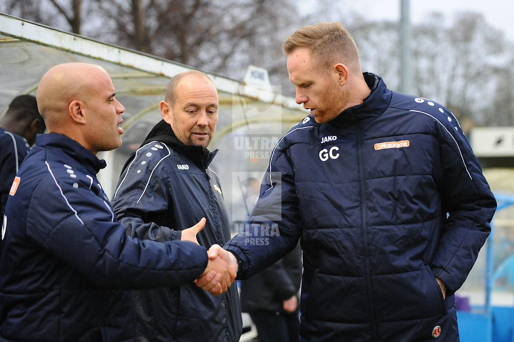 TELFORD COPYRIGHT MIKE SHERIDAN Gavin Cowan greets opposite number Marcus Bignot and Russ O'Neill(centre) during the Buildbase FA Trophy 3Q fixture between Guiseley and AFC Telford United at Nethermoor Park on Saturday, November 23, 2019.<br /> <br /> Picture credit: Mike Sheridan/Ultrapress<br /> <br /> MS201920-031