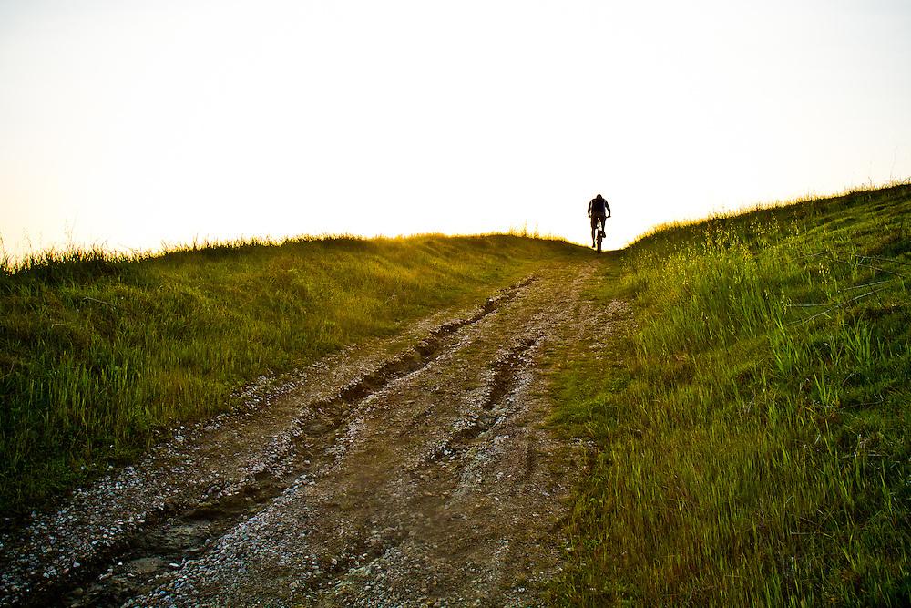 Dennis Lui climbs a trail, enjoying the ocean view, while mountain biking in Morro Bay, Calif.