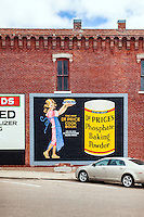 With funding from the Paul John Anton And Doris Wirth Foundation, muralist Kent Schwartz painted recreations of historic ads that once graced the buildings in downtown Nebraska City, Neb. Photo taken on Oct. 15, 2013.