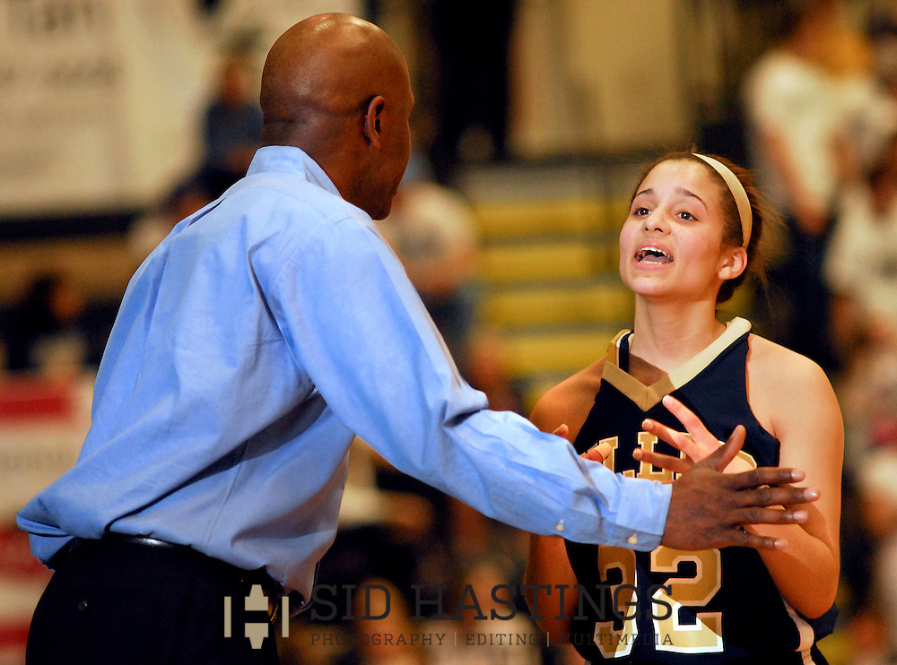 6 MARCH 2010 -- ST. CHARLES, Mo. -- Miller Career Academy basketball player Elyse Hart-Shelton (32, CQ) talks with MCA coach Darrin White (CQ) during MSHSAA GIrls' Class 4 basketball quarterfinals at Lindenwood University Saturday, March 6, 2010. Photo (c) copyright by Sid Hastings.