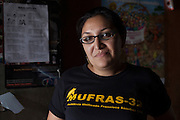 Zenaida Serrano, 32, member of MUFRAS-32, recalls the social conflicts in the area since the arrival of Pacific Rim's gold mining project in the mid 2000's. Pacific Rim's controversial El Dorado gold mine has been the focus of numerous social conflicts at local and national level. Three anti-mining local leaders were murdered in 2009. While a year before, former president Antonio Saca refused to authorize the company's mining permit. This action prompted Pacific Rim to invoked a provision of the Central American Free Trade Agreement (CAFTA) to place the matter in the hands of an international arbitration court. Oceana Gold, who took over Pacific Rim on October 2013 for US $10.2 million , now seeks US $300 million for damages agains the State of El Salvador. San Isidro, Cabañas, El Salvador. September 15, 2014.