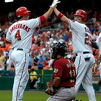 18 July 2007:  Washington Nationals left fielder Ryan Langerhans (4) is congratulated by Austin Kearns (25) after hitting a three run home run that scored Dmitri Young and Kearns in the 5th inning as Houston Astros catcher Eric Munson (13) waits for the next batter .  The Nationals defeated the Astros 7-6 at RFK Stadium in Washington, D.C.  ****For Editorial Use Only****