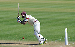 Somerset's Peter Trego cuts the ball off the bowling of Durham's Chris Rushworth.  - Photo mandatory by-line: Harry Trump/JMP - Mobile: 07966 386802 - 14/04/15 - SPORT - CRICKET - LVCC County Championship - Day 3 - Somerset v Durham - The County Ground, Taunton, England.