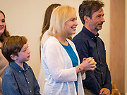 26 MAY 2019 - WATERLOO, IOWA: Sen. US Senator KIRSTEN GILLIBRAND (D-NY) with her husband, JONATHAN GILLIBRAND, and son, HENRY GILLIBRAND, 11, at Mt. Carmel Missionary Baptist Church in Waterloo Sunday. Sen. Gillibrand is on her 5th trip to Iowa this week to support her candidacy to be the Democratic nominee for the US Presidency. Iowa traditionally hosts the the first selection event of the presidential election cycle. The Iowa Caucuses will be on Feb. 3, 2020. Mt. Carmel Missionary Baptist Church was established in 1921 and is the third oldest African-American church in Waterloo. Waterloo has the largest African-American community in Iowa.             PHOTO BY JACK KURTZ