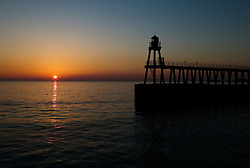 © Licensed to London News Pictures. <br /> 09/04/2017<br /> Whitby, UK. <br />  <br /> The sun rises over the harbour in Whitby in North Yorkshire. <br /> <br /> <br /> Photo credit: Ian Forsyth/LNP