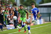 Oldham Athletic defender Alex Lacovitti tries to stop Forest Green Rovers defender Dominic Bernard (3) moving the ball forward during the EFL Sky Bet League 2 match between Forest Green Rovers and Oldham Athletic at the New Lawn, Forest Green, United Kingdom on 3 August 2019.