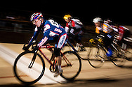 Cyclists cross the finish line during Tuesday Night Racing at the San Diego Velodrome on April 28, 2009.