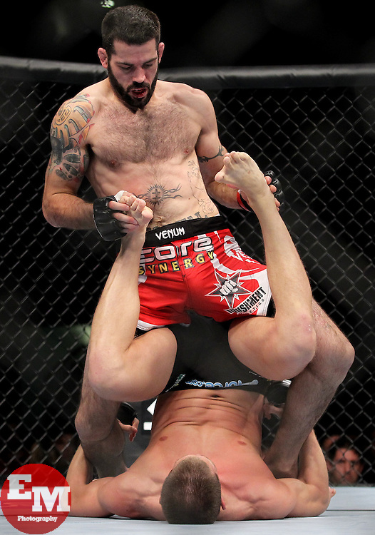 Atlanta, GA - April 21, 2012: Matt Brown (red trunks) and Stephen Thompson (black trunks) during UFC 145 at the Phillips Arena in Atlanta, Georgia.