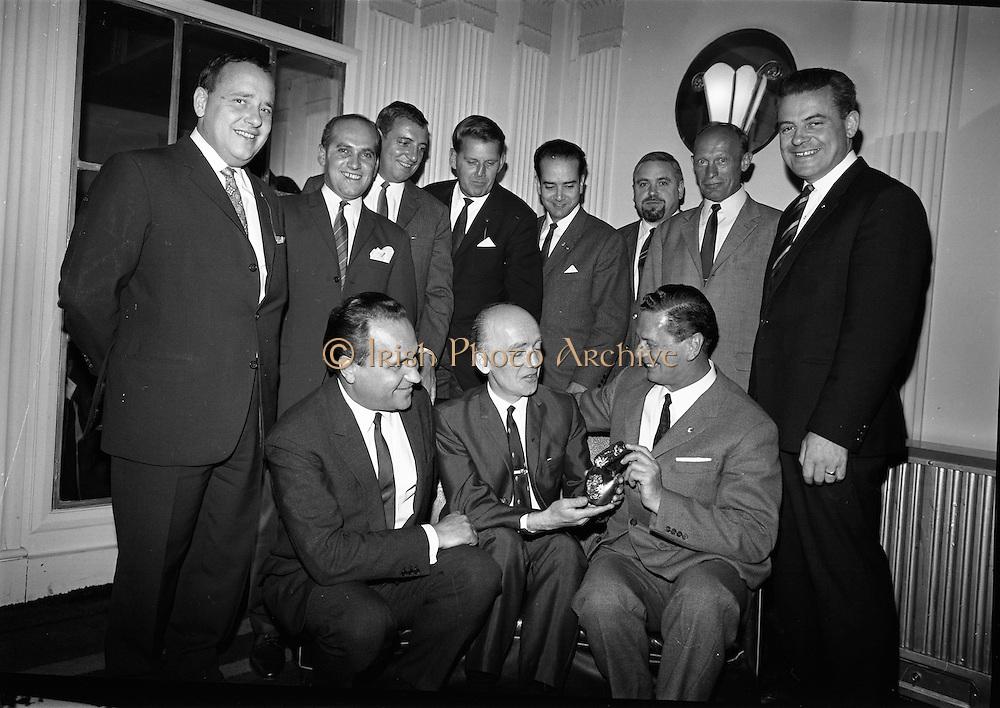 18/09/1967<br /> 09/18/1967<br /> 18 September 1967<br /> German barmen arrive in Dublin for Irish visit at the Gresham Hotel, Dublin. Picture shows (l-r): (seated) Mr Ernst Kirstein, Managing Director, Killarney Hotels Ltd.; Mr Paddy Flahive, Shelbourne Hotel, receiving a German cowbell from the German group) and Mr Maier, Cafe Bauer, Abersdorf (Obersdorf?). Standing (l-r): Mr Cremer, Charlie's Nightclub, Dusseldorf; Mr Mayer, Regina Palace Hotel, Munich; Mr Baymann, Carlton Hotel, Nuremburg; Mr Berenbrock, Hotel Mondial, Cologne; Mr Boadella, Spa Hotel, Baden-Baden; Mr Thrum, Domizil, Bad Horzburg; Mr Peter, Restaurant Brathandel, Munich and Mr Danny Toland, Secretary UKGB.