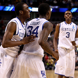 Mar 19, 2011; Tampa, FL, USA; Kentucky Wildcats guard Doron Lamb (20) and guard DeAndre Liggins (34) and forward Terrence Jones (3) celebrate following a win over the West Virginia Mountaineers in the third round of the 2011 NCAA men's basketball tournament at the St. Pete Times Forum. Kentucky defeated West Virginia 71-63.  Mandatory Credit: Derick E. Hingle