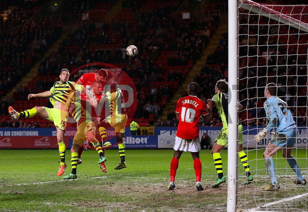 Charlton Athletic's Richard Wood heads towards goal but it is cleared off the line - Photo mandatory by-line: Robin White/JMP - Tel: Mobile: 07966 386802 08/04/2014 - SPORT - FOOTBALL - The Valley - Charlton - Charlton Athletic v Yeovil Town - Sky Bet Championship