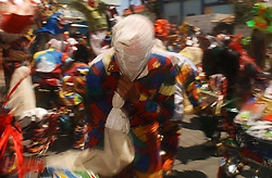 Devil Dancers dress in colorful costumes and dance with paper mache devil masks.  Venezuela is dotted with towns that celebrate Corpus Christi with a two day devil dancing celebration.  Each town has it's own tradition and own dress. Community members, dressed as devils, first dance in front of the Church asking for forgiveness from their sins.  They then parade through the town dancing making stops at  various homes along the way.  The houses all have stands with religious symbols and candles inf front of which  the Devil Dancers pray and beg forgiveness    It is considered an honor to dance during the celebration.