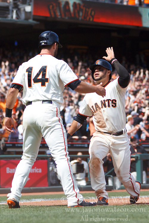 SAN FRANCISCO, CA - APRIL 26:  Gregor Blanco #7 of the San Francisco Giants celebrates with Brandon Hicks #14 after both scored runs against the Cleveland Indians during the fifth inning at AT&T Park on April 26, 2014 in San Francisco, California. (Photo by Jason O. Watson/Getty Images) *** Local Caption *** Gregor Blanco; Brandon Hicks