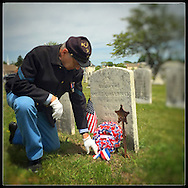 Hempstead, NY: May 2015--- A descendant of a Civil War soldier remembers his forefather on Memorial Day Ceremonies at Greenfield Cemetery in Hempstead, Long Island. © Audrey C. Tiernan