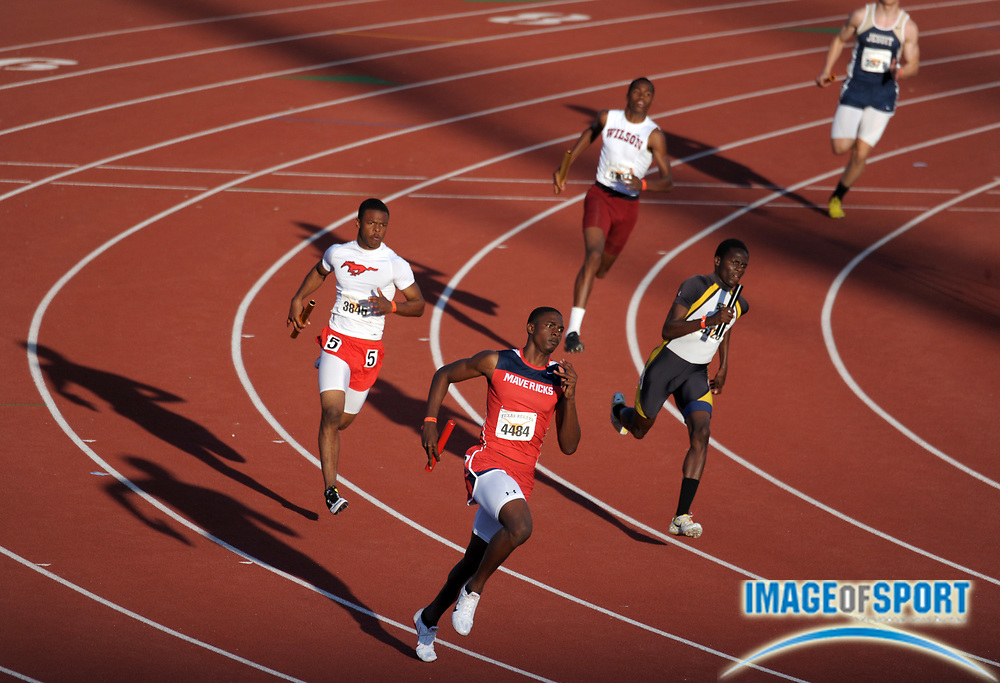 Mar 28, 2014; Austin, TX, USA; Runners cast shadows during the 400m leg of a boys sprint medley relay heat in the 87th Clyde Littlefield Texas Relays at Mike A. Myers Stadium.