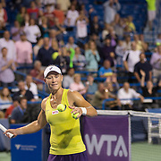 August 21, 2014, New Haven, CT:<br /> Samantha Stosur hits tennis balls into the crowd after defeating Kirsten Flipkens on day seven of the 2014 Connecticut Open at the Yale University Tennis Center in New Haven, Connecticut Thursday, August 21, 2014.<br /> (Photo by Billie Weiss/Connecticut Open)